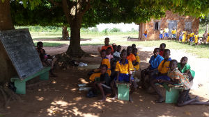 school under a tree, teacher and baby